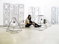 Sara Bernardi among hers Con-Tradition lanterns and room dividers