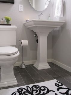 grey bathroom floor, black and white with random accent colors. I also love the pedestal sink for a half bath. Grey Bathroom Floor, Basement Bathroom, Bathroom Flooring, Modern Bathroom, Master Bathroom, Bathroom Small, Bathroom Ideas, Gray Floor, Bath Ideas