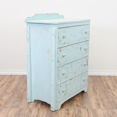 This shabby chic chest of drawers is featured in a solid wood painted in a light blue chalk paint. This tall dresser is in great condition with 4 large drawers and a carved curved backsplash. Simple storage piece perfect for a kid's room!   #shabbychic #dressers #talldresser #sandiegovintage #vintagefurniture