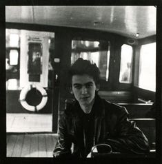 """George Harrison aboard an Alster ferry, Hamburg, April 1961 Photo: Jürgen Vollmer """"[P]rinted later, the black and white contact sheet with twelve photographs of George seated and standing in a ferry,..."""