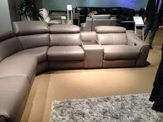 Power motion sectional with ratchet back.