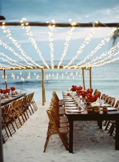 Keep it simple for your beach wedding reception with minimalist flower arrangements + fun string lighting.