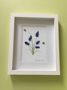 """""""Blue bell"""" this lovely unique pebble art is framed by me in 8x10 white shadow box as shown using very rare genuine cobalt blue sea glass. Thanks for your interest"""