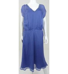 This is a really pretty dress in luxurious 100% pure silk. It features subtle embroidery and beading at the neckline and comes with spare beads still attached.  A lightweight dress that would be ideal for a cocktail party or a special night out with a loved