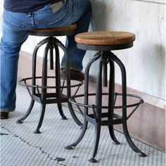 """$162.00 This amazing wood bar stool provides an effortlessly chic way to add an industrial flair to your decor. Strong metal construction and an adjustable seat made of reclaimed wood make this industrial factory stool pure perfection. This Reclaimed Wood Industrial Factory Stool is perfect for stylish bar seating, as a breakfast bar stool, or as an impromptu side table seat too!   Made of reclaimed wood and metal. Seat 12.5"""" wide. Dimensions: 16"""" x 16"""" x 25""""-32""""H."""