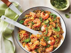 Shrimp Fried Rice Recipe | You will never order take out again once you discover how fast it is to whip up this tasty, one-pan Shrimp Fried Rice. This delicious take on everyone's favorite fried rice, ready in just 15 short minutes, is the perfect dish for a late summer meal. Fried rice is best when made with cooled, day-old rice, which is drier and less sticky. Make the rice in advance, then sore in the refrigerator or freezer. Or, cool down freshly-cooked rice by spreading it out on a…