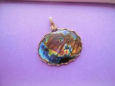 The Big, The Bold, and The Beautiful- Spectralite Labradorite Pendant wrapped in 14k Gold Wire by WrappedStoneWonders on Etsy
