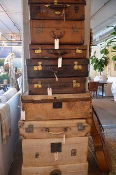 stacks of luggage - via velvet and linen