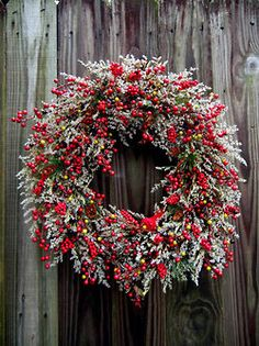 Beautiful holly berry and herb wreath idea.