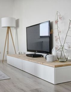 Scandinavian - you could use Ikea Besta units topped with a timber top or kitchen bench top