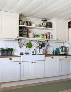 Ikea kitchen...butcher block!  Farm sink, cute cabinets & open shelving..