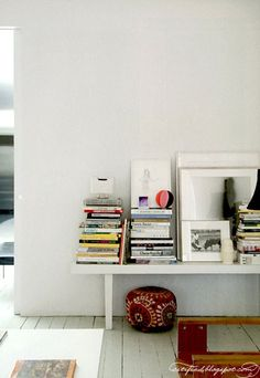 I may just have to give up on bookshelves and start creating lovely piles like these :)