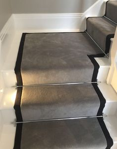 Wool Velvet grey carpet with black taping fitted as a stair runner with Chrome stairs to a white painted staircase Grey Stair Carpet, Carpet Staircase, White Carpet, Carpet For Stairs, Stairs With Carpet Runner, Grey Carpet Hallway, Wool Carpet, Black Staircase, Houses