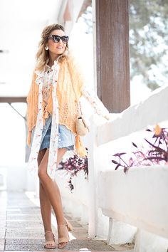 NEW WATCH – Mi Aventura Con La Moda. White Flamingo print blouse+denim skirt+nude ankle strap midi heeled sandals+light orange short poncho+nude chain shoulder bag+sunglasses+earrings. Spring Casual Outfit 2017