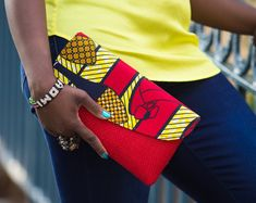 African hand made high quality clutch made from local materials and African print material. Clutches could be used for night out, casual day out, bridesmaid party gifts, etc. Different colors available upon orders.