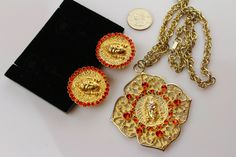 Vintage Judy Lee  1960s Hindu Goddess necklace & earrings   with orange/Hyacinth Rhineatones by Jewelrin on Etsy https://www.etsy.com/listing/224386165/vintage-judy-lee-1960s-hindu-goddess