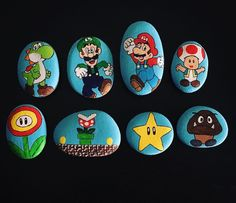 Rock Art Ideas and Inspiration. There's something special about rock painting. Instead of having a big canvas or a blank piece of paper to work with, rock art forces you to come up with a creative idea that will fit one particular shape and size. Rock Painting Ideas Easy, Rock Painting Designs, Paint Designs, Pebble Painting, Pebble Art, Stone Painting, Yoshi, Minion Rock, Rock Design