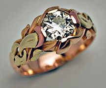 Art Nouveau Antique Russian Solitaire Diamond Men's Gold Ring: Made in Odessa (Russia) between 1899 & 1908. The ring is crafted in 56 zolotniks (14K -583), intertwined leaf design in three color gold - green, yellow, pink, & embellished with one Old European cut round brilliant diamond / http://www.romanovrussia.com/Art_Nouveau_Antique_Russian_Diamond_Mens_Ring.html