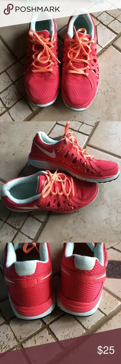 Nike Dual Fusion running shoes👟Coral color! Women's Nike Dual Fusion size 9.5 tennis/running shoes. Beautiful coral color! Great used condition. Lots of life left in these! There is some wear to the strings, please look at pics. Nike Shoes Athletic Shoes