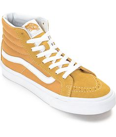 A slimmer sk8-hi made for the ladies of Vans! This sunny amger gold colorway features a suede and canvas upper, vulcanized outsole for cruising on your board, and the classic Vans Waffle tread for grip. Pair these beauties with some black distressed jeggi