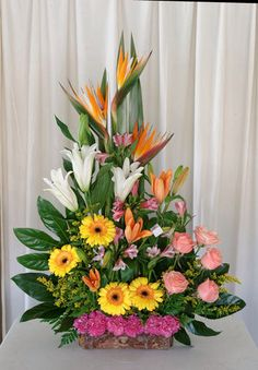 Selecting The Flower Arrangement For Church Weddings – Bridezilla Flowers Tropical Flower Arrangements, Funeral Flower Arrangements, Beautiful Flower Arrangements, Beautiful Flowers, Altar Flowers, Church Flowers, Funeral Flowers, Exotic Flowers, Tropical Flowers