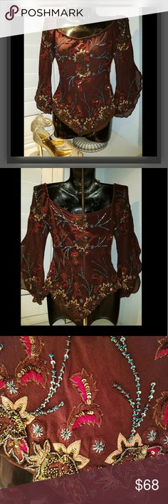 """Vintage Boho Burgundy Silk Bead Ruffle Blouse Boho Style blouse is stunning.   Gently used! The beads do not appear to be missing and everything is great preloved condition.   Perfect for a tiny medium   Aftershock V cut on bottom  Ruffle sleeves Looks like it can be worn off the Shoulder   Size Medium  Breast 32"""" Waist 24"""" Length 20""""   Stop by my closet for more great fashion deals Aftershock Tops Blouses"""