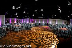 A total room transformation - this group draped the walls and used dramatic colored lights plus patterned lights on the floors. They also rented silver chairs and smaller tables to create a unique look.