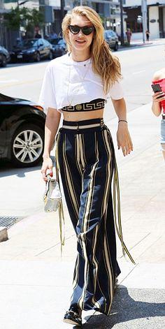 72b56eaf753 in striped plazo and elegant sling bag Gigi looking so cool😍 Bella Gigi  Hadid