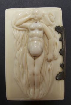 An ivory anatomical model carved into the lid of a hinged box
