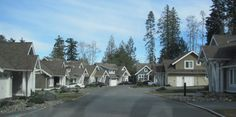 This tiny subdivision outside of Qualicum Beach comes close to getting it right.  Still entirely car-centric, with no commercial component.