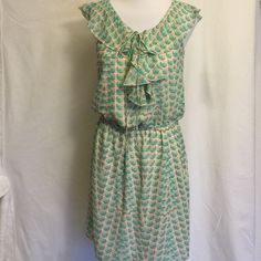 """Cute Dress Chiffon Ruffled Top w Tie small Cute Dress with Chiffon Ruffled Top w Tie.  Gently used, good condition.  Elastic waist to accentuate. Sheer but lined.  Purchased at Nordstrom Rack.  Cute mint green/grey/cream print.  small.  100% polyester. Bust 16"""" length 35"""". Max Studio Dresses"""