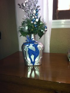 Crown Royal bottles spray painted metallic silver, hot glued Dollar Tree ornament and added some picks from Michaels. Christmas Holidays, Christmas Ideas, Merry Christmas, Christmas Decorations, Xmas, Holiday Decor, Empty Bottles, Wine Bottles, Crown Royal Bottle