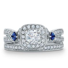 Set into the bezel are two princess-cut blue sapphires, a symbol of everlasting love.