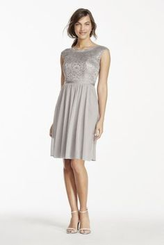 This beautiful metallic lace dress is perfect for a wedding party or any special event!  Features cap sleeve illusion metallic lace boatneck bodice, mesh skirt and grosgrain ribbon at waist.  Fully lined. Back zip. MetallicLace 100% Nylon, Mesh 100% Polyester. Dry clean only.  To protect your dress, try our Non Woven Garment Bag.