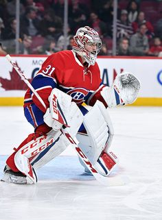 Carey Price of the Montreal Canadiens protects the net against the Carolina Hurricanes in the NHL game at the Bell Centre on November 24 2016 in...