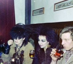 Pete Burns of Dead or Alive, his then-wife Lynn and Pete Griffiths of the Spitfire Boys having a drink in the Grapes in Mathew Street, which was, back then, a focal point for many Liverpool bands.