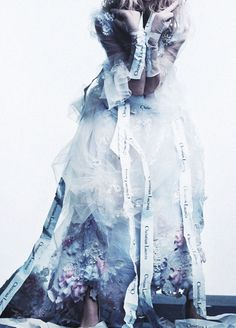 Detail of Sasha Pivovarova in a frothy tulle wedding gown with flowerful details from the Christian Lacroix Haute Couture Spring/Summer 2006...