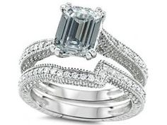 Emerald Cut White Topaz Diamond Engagement Ring Wedding Set - A classic vintage style design that will compliment a classy lady comes this brilliant Emerald Cut White Topaz Diamond Engagement Ring Wedding Set stamped in 925 Sterling Silver placed within a Prong setting featuring a White Topaz Emerald cut center stone with White Round cut accent sides stones on the vintage style shank. #unusualengagementrings