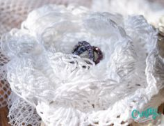 Crochet flower on a bird cage veil http://craftymothertrucker.com