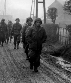 Troops from the US 28th Infantry Division, Bastogne Belgium, December 1944. Most are wearing M43 field jackets. US Army