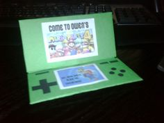 """This is a bad picture but great idea for a Mario party -- invitation is a ds, and then use a picture from the """"Mario party"""" game that corresponds to the child's age (ex. We would use Mario Party 5 for Leila)"""