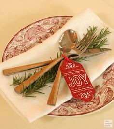 A cute holiday tag, combined with rosemary makes the perfect place setting for your Christmas dinner table.   You can add a variety of tags for each guest!