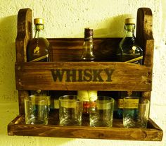 Items similar to Rustic Whisky and Spirit rack with glasses shelf made from reclaimed pallet wood, can be personalised on Etsy Diy Furniture To Sell, Wooden Pallet Furniture, Wood Pallets, Bottle Rack, Wine Bottle Holders, Whisky Regal, Whisky Bar, Whiskey, Pallet Wine