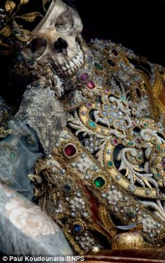 A relic hunter has lifted the lid on a macabre collection of 400-year-old jewel-encrusted skeletons unearthed in churches across Europe.   Art historian Paul Koudounaris hunted down and photographed dozens of gruesome skeletons in some of the world's most secretive religious establishments.