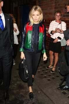 In A Gucci Jacket And Loafers And A Givenchy Bag - In London, 2017