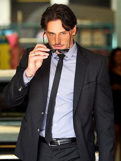 """Gideon Cross in the Crossfire Building.  """"I had never seen hair that purely black. It was glossy and slightly long, the ends drifting over his collar. That sexy length was the crowning touch of bad boy hotness over the successful businessman, like whipped cream topping on a hot fudge brownie sundae. As my mother would say, only rogues and raiders had hair like that."""" (Eva about Gideon)"""""""