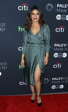 25 times Priyanka Chopra stunned us in 2016:       In a silk trench dress from the Burberry x Barneys collection at PaleyFest New York 2016 in New York City on Oct. 17.