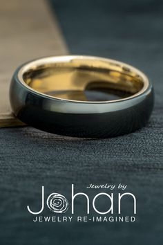 This black zirconium wedding band has a comfort fit white gold sleeve for a mix of modern and classic stylings. #JewelrybyJohan