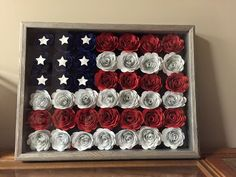 Shadow box American flag made with paper flowers.