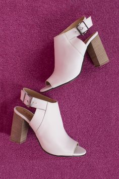 http://www.danielfootwear.com/women-c2/designer-heels-c283/white-leather-flaunter-sling-back-mule-sandal-p80614